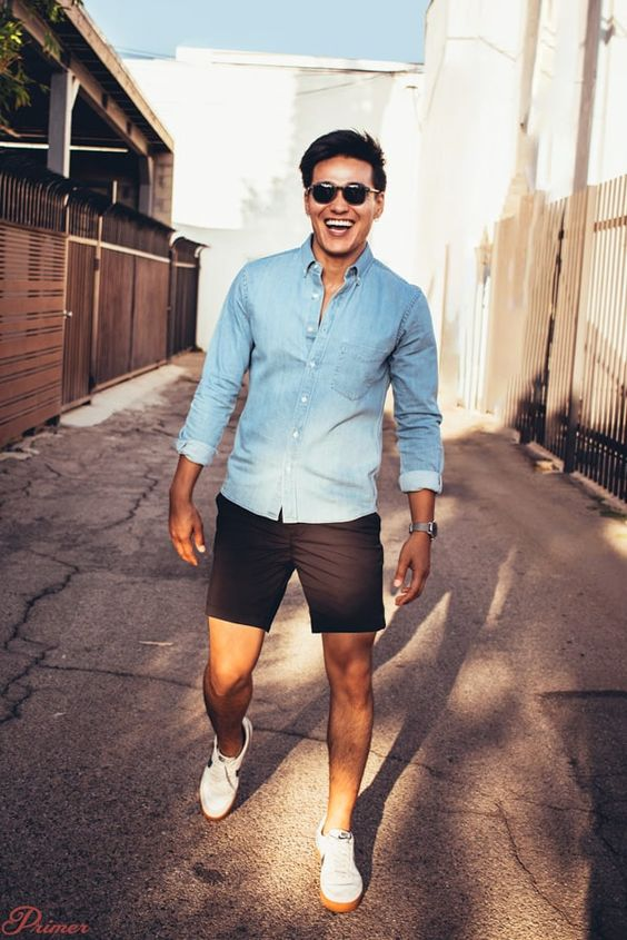 a chambray shirt, black shorts, white sneakers for a simple and cool summer outfit