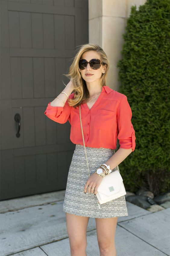 a coral shirt, a grey printed mini skirt and a white bag for a hot summer day at work