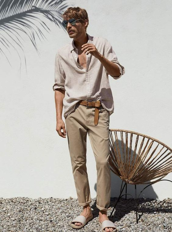 a linen shirt, tan pants, slippers for a relaxed look on a hot summer day
