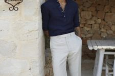 a navy long sleeve shirt, creamy pants, printed mules for a chic yet relaxed vacation look