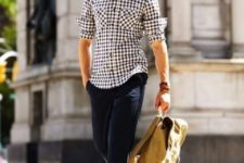 a navy plaid shirt, navy cropped pants, brown moccasins and a backpack