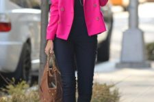 a navy top, navy skinnies, tan shoes with gold touches, a magenta blazer and a brown bag