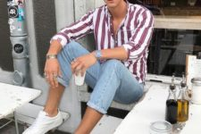 a pink and burgundy striped shirt, blue skinnies and white sneakers for a cool summer look