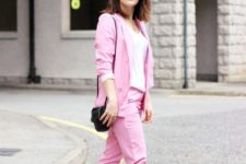 a pink pantsuit, navy sneakers, a black bag and a white top for a brigth casual summer work look