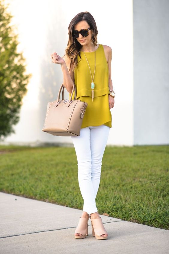 a spring work look with a mustard sleeveless tee, white pants, tan mules and a tan bag