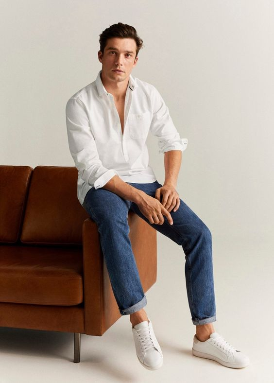 a white long sleeve shirt, blue jeans and white sneakers for a casual summer look