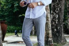 a white long sleeve shirt, grey pants and navy espadrilles for a tropical or vacation outfit