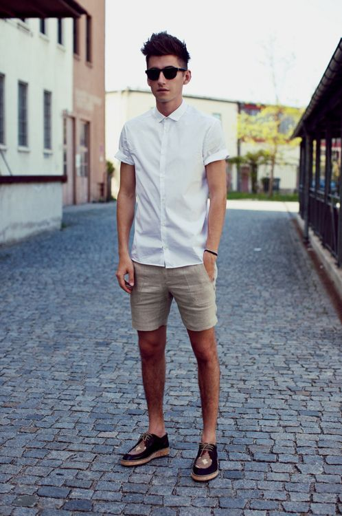 a white short sleeve shirt, tan shorts, two tone shoes for a simple summer outfit