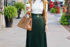 a white tee, a dark green pleated midi, tan shoes, a tan bag and a mustard sweater