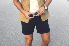 a white tee, a mustard shirt, black shorts, white sneakers for a summer day