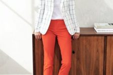 a white tee, a windowpane blazer, rust cropped pants, black flat shoes and a necklace
