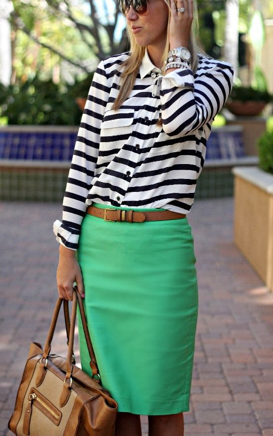 a bright look with a striped black and white shirt, a green skirt and a brown bag for a modern work look