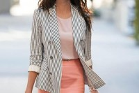a blush top, a peachy skirt, a striped blazer, a two-tone bag and cool retro sunglasses