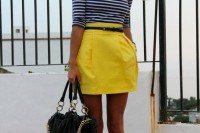a striped navy and white top, a yellow mini skirt, black shoes and a black bag to rock this summer