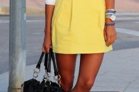 a white shirt, a sunny yellow mini skirt, black flats, a black bag and a statement necklace for a summer work outfit