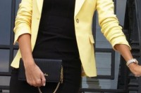 a black mini dress, a yellow blazer, a black necklace and a mini bag for a bold summer work look
