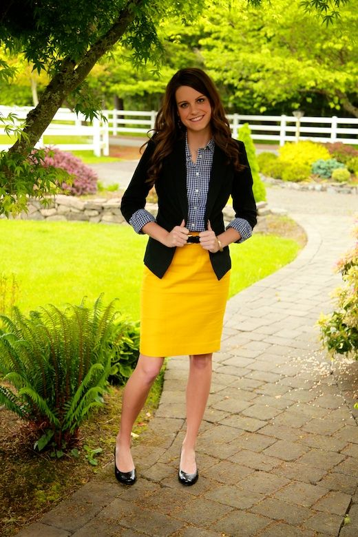 a navy plaid shirt, a black blazer, a sunyn yellow midi, black shoes for a spring or summer look