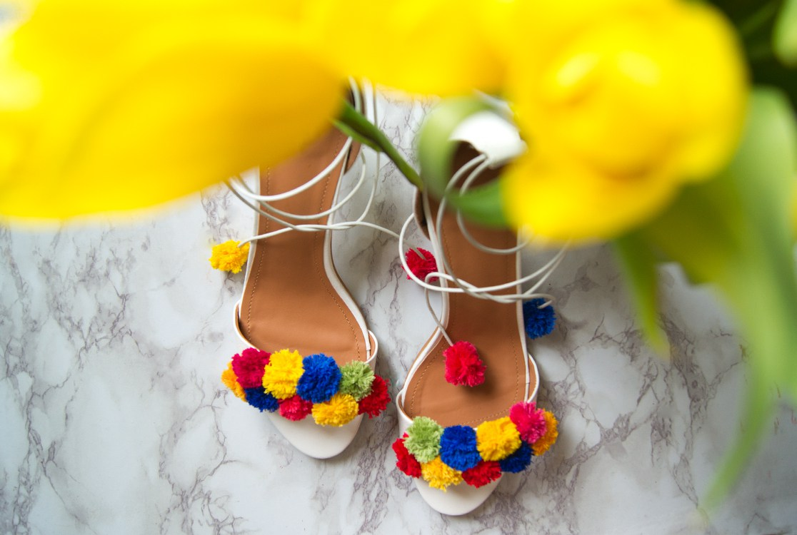 Picture Of flirty and bold diy pompom heels  3