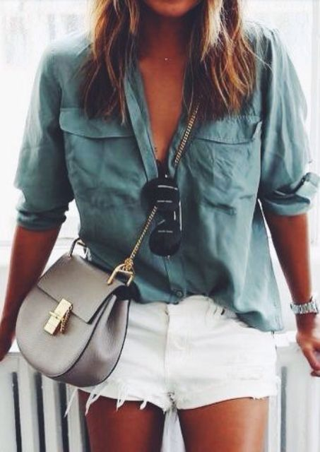 a green shirt and white denim shorts