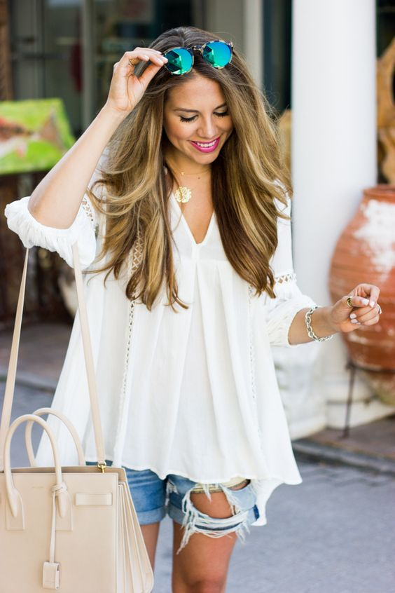 a white tunic and boyfriend shorts