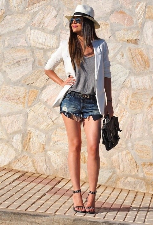grey top, white jacket and denim shorts