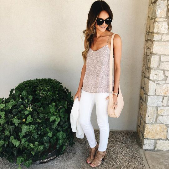 white jeans, a tank top and scrappy sandals