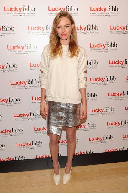 Casual white sweatshirt and asymmetrical metallic skirt look