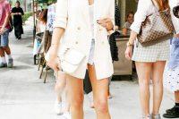 Chrissy Teigen Rocks Frayed Denim Shorts With A Chic White Blazer