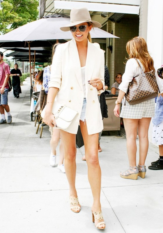 Chrissy Teigen Rocks Frayed Denim Shorts With A Chic White Blazer