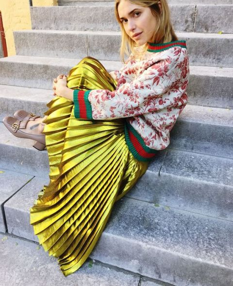 Eye-catching look with golden skirt and floral sweatshirt