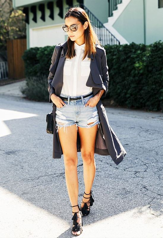 Frayed Denim Shorts With Black Heels And A White Blouse