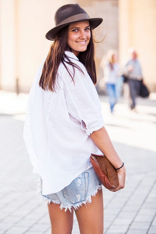 Frayed Jean Shorts And An Oversized White Button-Down Shirt