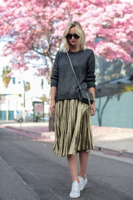 Outfit with grey shirt, metallic skirt and white sneakers