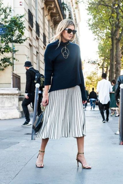 Outfit with metallic skirt and black sweater