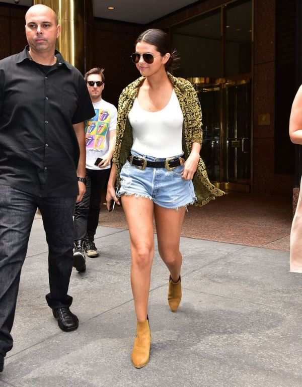 Selena Gomez Rocks Belted Denim Shorts With A White Tank And Ankle Boots