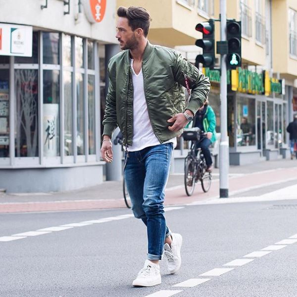 Picture Of Skinny Jeans With White Sneakers And A Navy Bomber Jacket