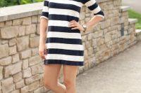 Striped dress with baseball cap