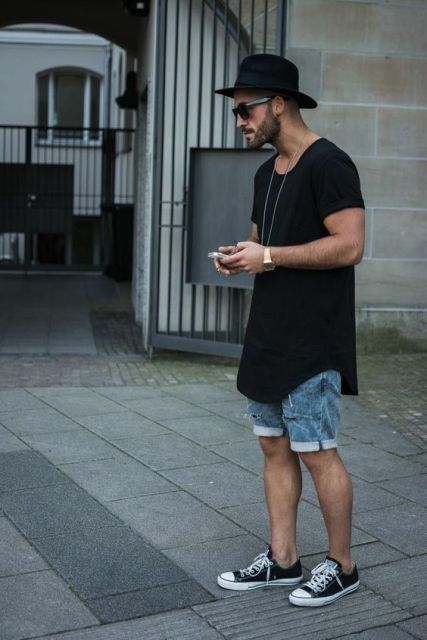 Stylish men hat with loose t-shirt and denim shorts