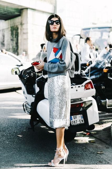 Stylish outfit with metallic skirt, grey loose sweatshirt and graphic bag