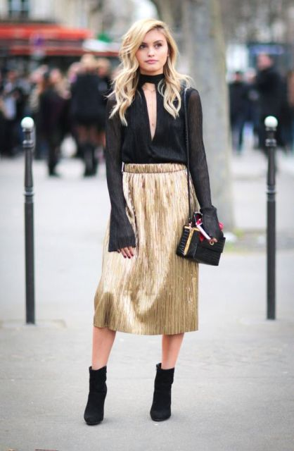 Trendy look with black blouse and golden skirt