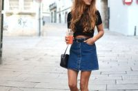 02 button down denim skirt with a black crop top and sneakers