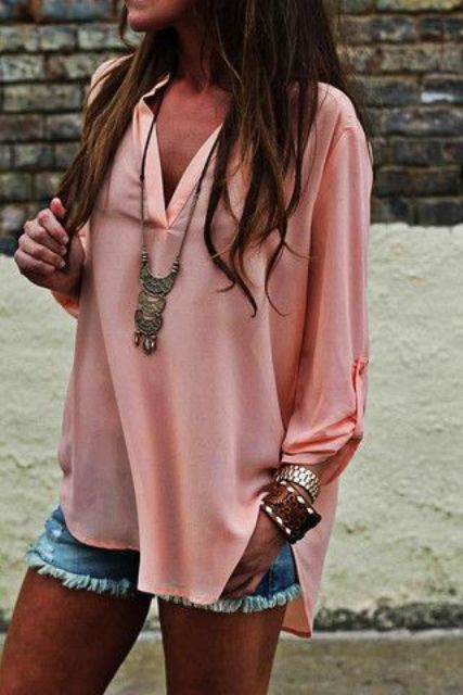 loose coral shirt with denim shorts