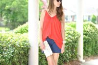 04 blue patterned shorts, a red top and a white clutch