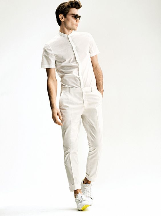 a white short-sleeved shirt and trousers with sneakers