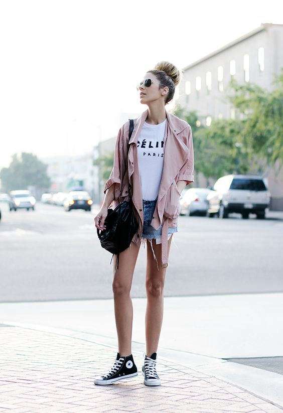 denim shorts, a white tee, pink jacket and high top sneakers