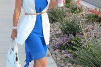 09 blue dress, a white long vest and a skinny belt