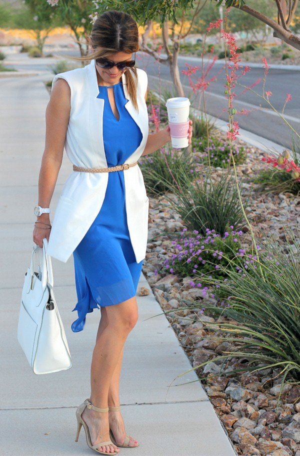 blue dress, a white long vest and a skinny belt
