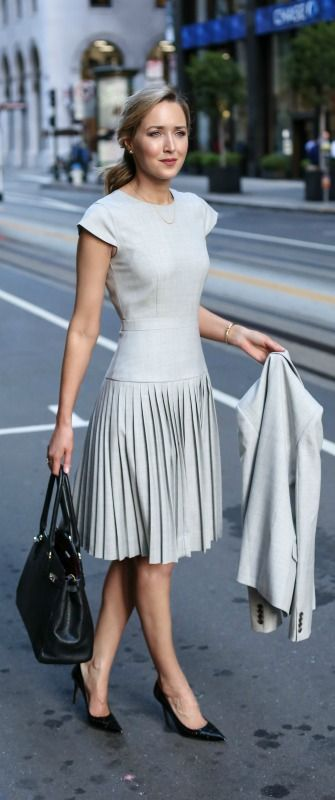 light grey pleated dress with a jacket