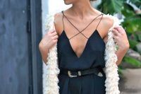 12 black criss cross dungaree and a knit stole