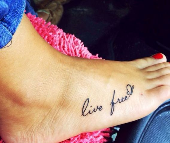 meaningful phrase foot tattoo